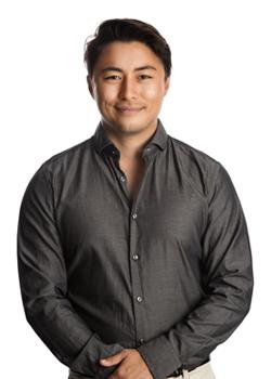 Young business man smiling wearing grey dress shirt